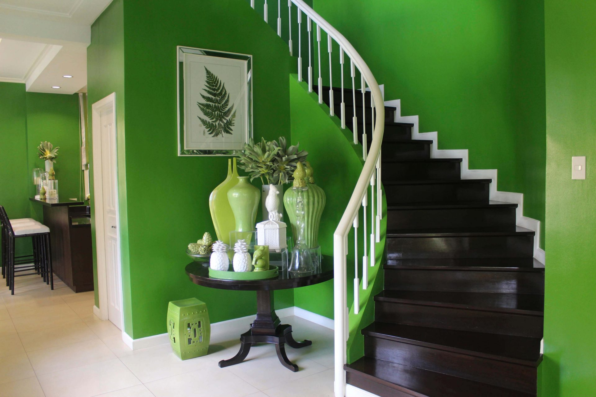 Vista Alabang | Portofino Heights | Rafaello House Model Brown Spiral Staircase with Green Walls | Luxury Homes by Brittany Corporation