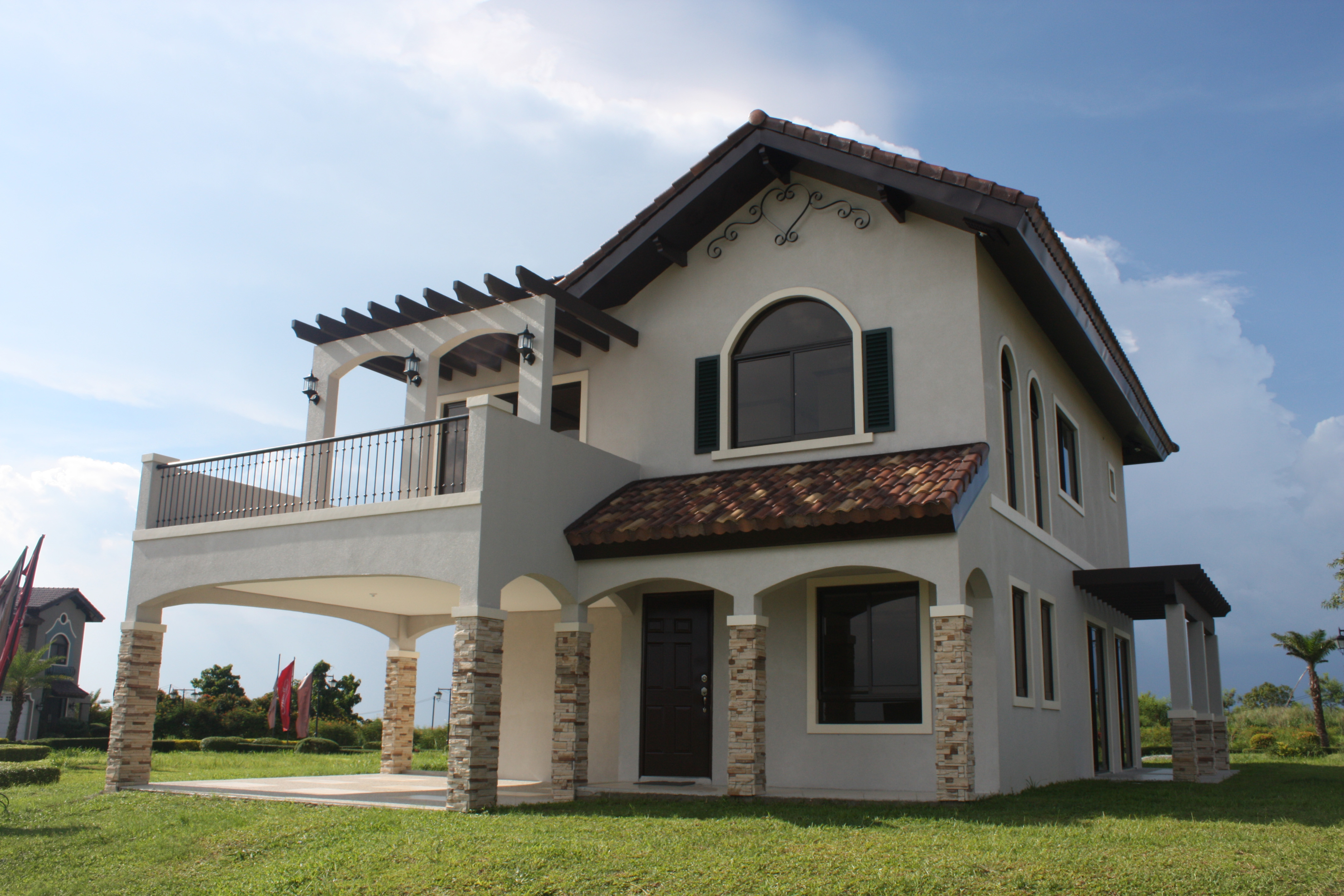Wide shot of the facade of the Carletti Luxury House and Lot Model | Vista Alabang | Amore at Portofino | Luxury Homes by Brittany Corporation