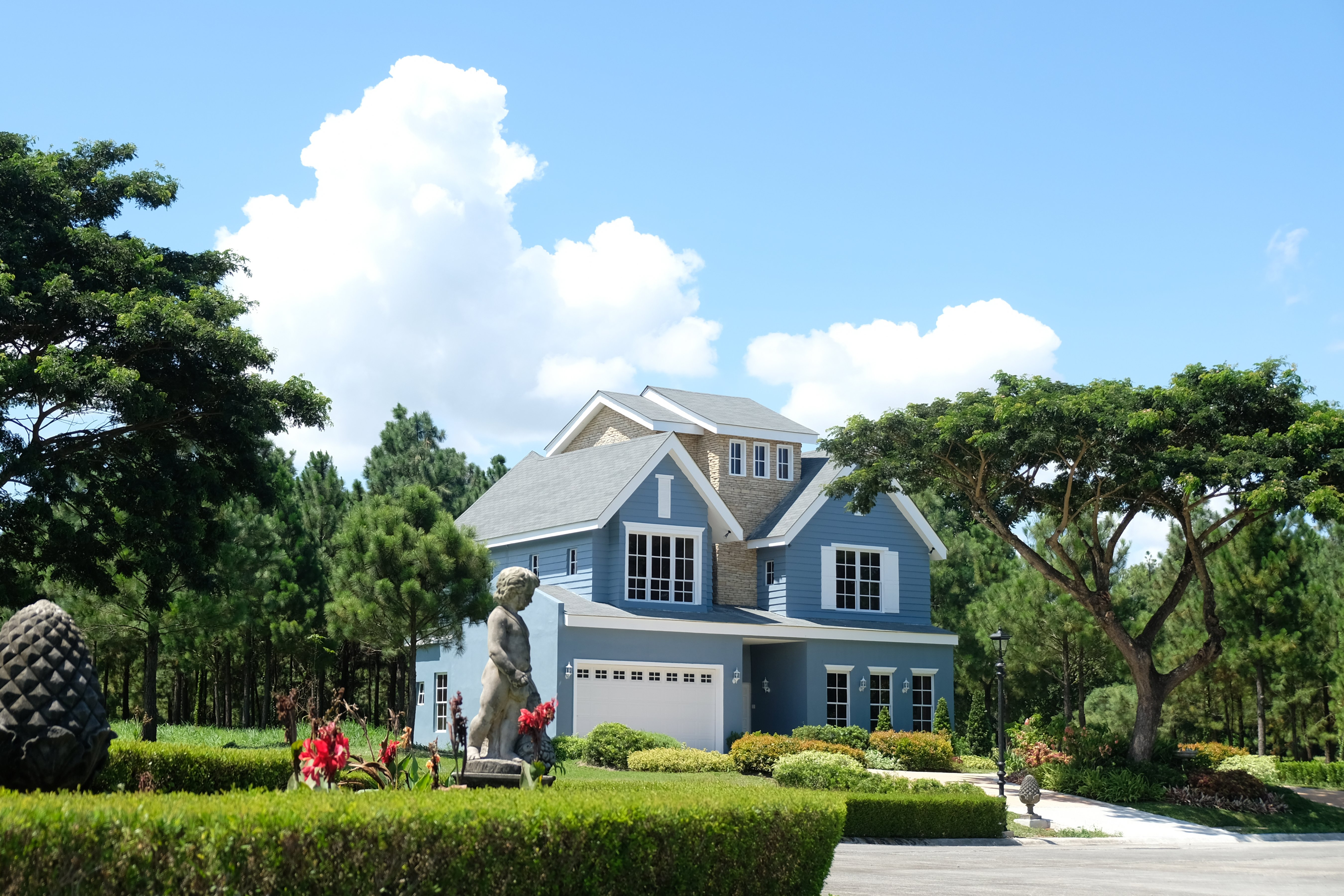 A wide shot featuring the facade of the Elliot Model House and its surrounding landscape | Brittany Sta. Rosa | Promenade | Luxury Homes by Brittany Corporation