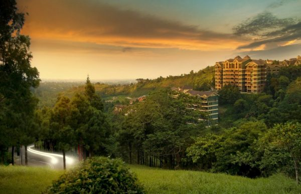 Sunset views over green lush mountains and a swiss-inspired hotel that overlooks the scenery