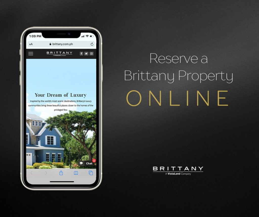 Iphone with eliot luxury smart home on the scree n with black background that says reserve a brittany property online   luxury homes by brittany corporation