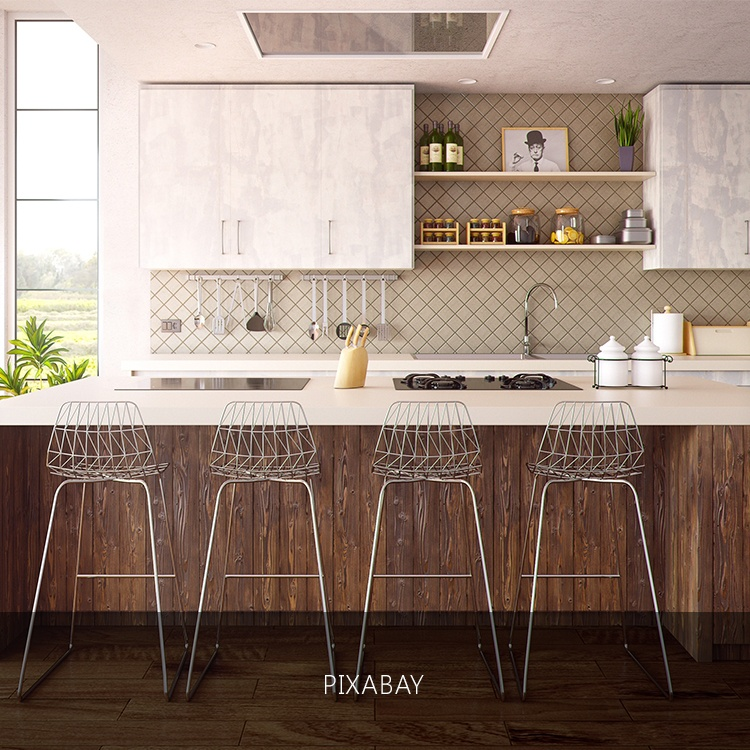 4 barstool in a bar slash kitchen with wooden panelings in a luxury home | Luxury homes by brittany corporation