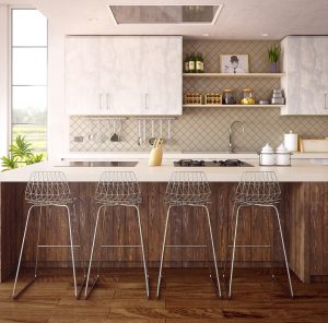 Four barstools in a wide kitchen area with a tabletop stove in a luxury home | Luxury Homes by Brittany Corporation