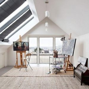 A sleek modern attic converted into an art studio | Luxury Homes by Brittany Corporation