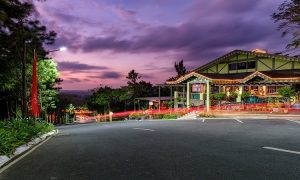 A long exposure shot of Crosswinds Drive with the retail row and Pine Cone Trail in sight at Crosswinds Tagaytay | Luxury Homes by Brittany Corporation