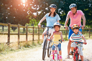 A family biking in the outdoors near their luxury house and lot | Luxury homes by Brittany Corporation