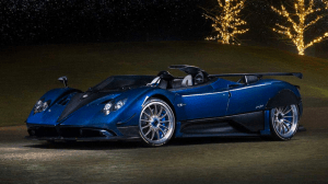Most expensive luxury car in the world | Sleek royal dark blue pagani luxury sports car in the night time | Luxury Homes by Brittany