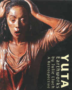 Julie Lluch Yuta Collection | Poster of a statue of a shocked woman gawking and looking down as she holds her head while wearing a long sleeved shirt and a red apron; and the artwork description on the lower right | Luxury Homes by Brittany Corporation