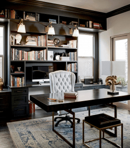 luxurious classy home office with white leather office chair and other modern-classic furniture with hints of gold, a grand wooden shelf at the back, on a traditional carpet | Luxury Homes by Brittany Corporation