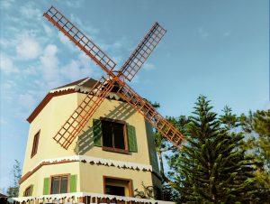 The iconic windmill overlooking the scenic view of pine trees and hills in Tagaytay, only found in Crosswinds | Luxury Homes by Brittany Corporation