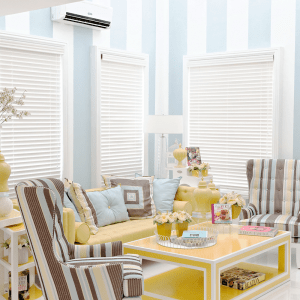 The blue, yellow, and white-themed living room at Audrey, a luxury house model in Augusta, Brittany Sta. Rosa | Luxury Homes by Brittany Corporation