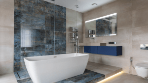 Sleek modern bathroom with a centerpiece minimalist bathtub next to a glass door shower room, on an elevated floor with backlight, also showing a clean mirror with built in vanity lights above a sink, as well as an automatic toilet with bidet | Luxury Homes by Brittany Corporation