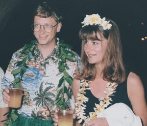 A young Bill and Melinda Gates in a Hawaiian-themed party, celebrating their high-profile marriage | Luxury Homes by Brittany Corporation