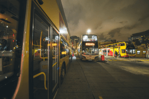Picture of buses at night transporting people around the city | Luxury Homes by Brittany Corporation