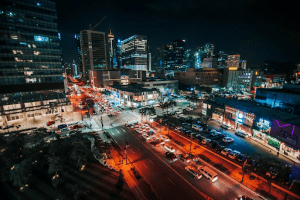 Night skyline of Bonifacio Global City where residents of luxury homes and luxury condos get to attend a webinar at the comfort of their own home | Luxury Homes by Brittany Corporation