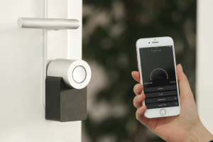 smart home device application showing doors to lock | Luxury Homes by Brittany Corporation