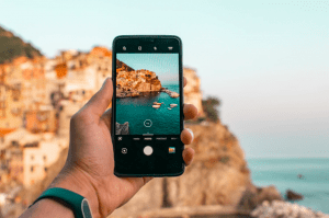Taking a photo of rock formation on mobile phone - Luxury homes in the Philippines