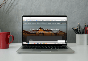 A laptop showing a form wherein you can succeed in real estate   Luxury Homes by Brittany Corporation