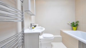 Sleak designed white themed bathroom of a luxury condo for sale in the Philippines | Brittany Corporation