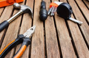 Steel measuring tape pliers and a hammer are some essential items one needs when mainting and caring for their luxury home | Brittany Corporation