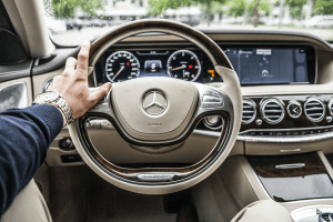 The steering wheel of a Mercedes Benz luxury car evokes the emotions of luxury   Brittany Corporation