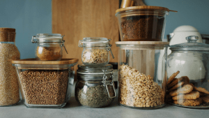 Various glass jars filled with dry goods like herbs and spices in the pantry of a luxury home for sale in the Philippines | Brittany Corporation