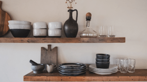 Wooden cupboard filled with black ceramic utensils and plates in a luxury home for sale in the Philippines | Brittany Corporation