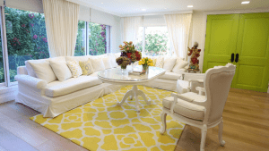 Light-colored luxury home interior with patterns and view of backyard garden.   luxury homes by brittany corporation