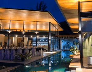 Ultra-modern mansion with open-air events and function area and an infinity pool.   luxury homes by brittany corporaiton
