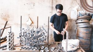 Furniture designer interior design student working on detailed craftsmanship artwork   luxury homes by Brittany Corporation
