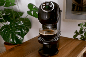Black modern coffee machine on wooden table | Luxury Homes by Brittany Corporation