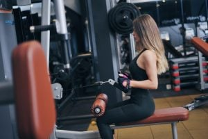 Caucasian woman working out in the gym | Luxury Homes by Brittany Corporation