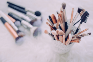 Different kinds of makeup brushes in a container   Luxury Homes by Brittany Corporation