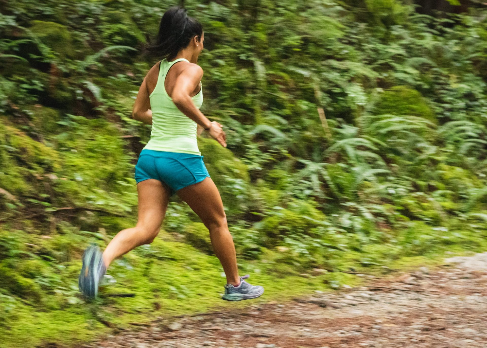 Healthy woman running through a dirt trail to stay fit | Luxury Homes by Brittany Corporation