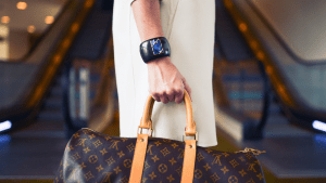 Caucasian woman holding designer bags on her way to her luxury condominium in the Philippines | Luxury Homes by Brittany Corporation
