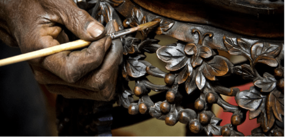 Man taking care of retouching and maintaining antique furniture | Luxury Homes by Brittany Corporation