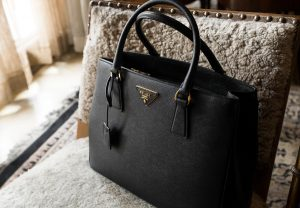 Prada Galleria Saffiano leather large bag on a couch in Alpine Villas | Luxury Homes by Brittany Corporation