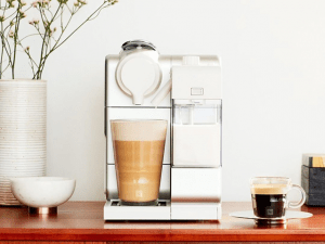 Simple clean modern coffee maker on a brown table | Luxury Homes by Brittany Corporation