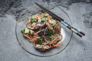 Healthy asian cuisine food noodles with chopsticks   luxury lifestyle and homes by brittany corporation