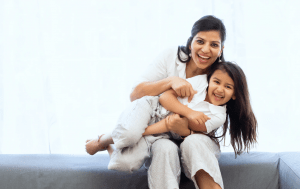 Happy family of indian mother and daughter in a clean home   luxury lifestyle and homes by brittany corporation