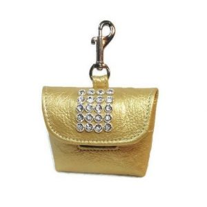 Expensive golden purse or dog poop bag with holder and clip for wealthy pets | luxury lifestyle and homes for Brittany Corporation