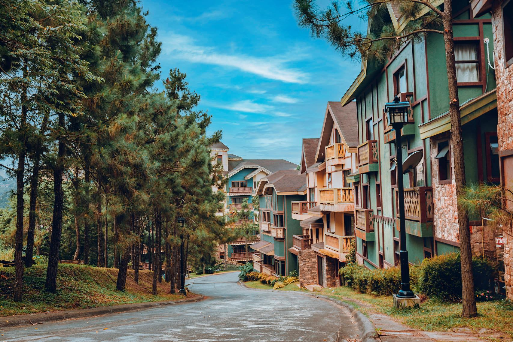 Swiss quadrilles mountain chalets surrounded by pine trees in cool climate of crosswinds luxury condominium developments in tagaytay | luxury lifestyle and homes by brittany corporation