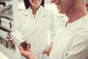 woman and man couple checking paraben-free products at the pharmacy   luxury homes by brittany corporation