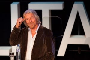 Sir Richard Branson speaking during a conference | luxury homes by brittany corporation