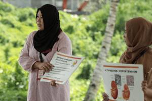 Filipino humanitarian Joy Amer conducting an information campaign on noncommunicable diseases in neglected areas in Mindanao province. Image by CARE Philippines. medical mission | luxury homes by brittany corporation