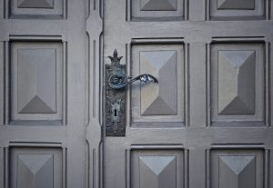 Gray Wooden Closed Door of a Luxury Property for Sale - Brittany Corporation