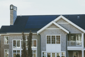 Image of a solar powered luxury house and lot with the solar panels placed on the roof - Brittany Corporation