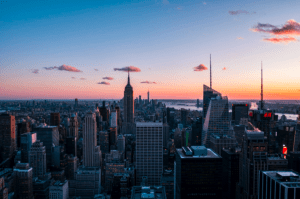 Photo of a sunset scenery with tall buildings and skyscrapers of the city in New York USA - Brittany Corporation - Scenic Destinations around the world