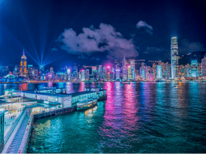 Photo of the bay area night scene with skyscrapers in one of the most visited cities to travel in Hong Kong - Brittany Corporation - Scenic Destinations around the world