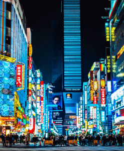 Photo of the busy streets and night sceneries in one of the most visited cities to travel in Tokyo Japan - Brittany Corporation - Scenic Destinations around the world
